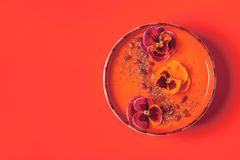 Smoothie bowl with edible pansy flowers, chia seeds, goji berries stock images