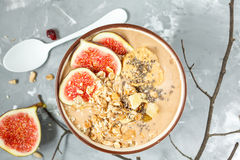 Smoothie bowl with figs, peanut butter and muesli. Stock Photos