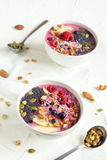 Smoothie bowl. With fresh berries, nuts, seeds and homemade granola for healthy breakfast Stock Image