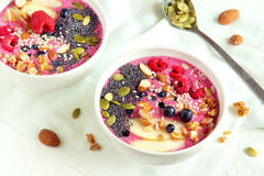 Smoothie bowl. With fresh berries, nuts, seeds and homemade granola for healthy breakfast Stock Photo