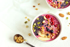 Smoothie bowl. With fresh berries, nuts, seeds and homemade granola for healthy breakfast, copy space Stock Photo