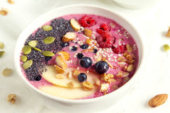 Smoothie bowl. With fresh berries, nuts, seeds and homemade granola for healthy vegan vegetarian diet breakfast Royalty Free Stock Photography