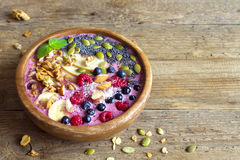 Smoothie bowl. With fresh berries, nuts, seeds and homemade granola for healthy vegan vegetarian diet breakfast Royalty Free Stock Photo