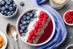 Smoothie bowl with fresh raspberry, blueberry, coconut flakes and chia seeds. Top view. Smoothie bowl with fresh raspberry, blueberry, coconut flakes and chia Royalty Free Stock Photo