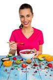 Smoothie bowl with happy young woman. royalty free stock image
