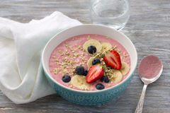 Smoothie bowl with sprouted green buckwheat, strawberries, blueberries and bananas Stock Photos