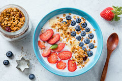 Smoothie bowl with strawberries, blueberries and granola. Superfood smoothie bowl with strawberry, blueberry and super foods: chia seeds, acai berry, granola stock images