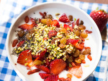 Smoothie bowl with strawberries, dried fruit and chia seeds Stock Photos