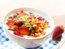 Smoothie bowl with strawberries, dried fruit and chia seeds Royalty Free Stock Photo