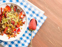 Smoothie bowl with strawberries, dried fruit and chia seeds Stock Photography
