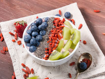 Smoothie bowl with strawberry smoothie, berries, kiwi and chia Stock Images