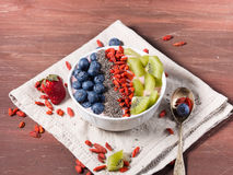 Smoothie bowl with strawberry smoothie, berries, kiwi and chia Royalty Free Stock Photos
