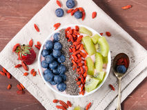 Smoothie bowl with strawberry smoothie, berries, kiwi and chia Stock Image