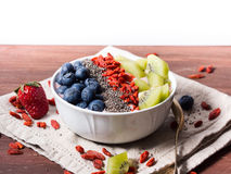 Smoothie bowl with strawberry smoothie, berries, kiwi and chia Royalty Free Stock Image