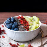 Smoothie bowl with strawberry smoothie, berries, kiwi and chia Stock Photo