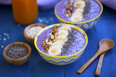 Smoothie bowls with blueberries, nuts , bananas and chia seeds,. Healthy vegan breakfast Stock Image