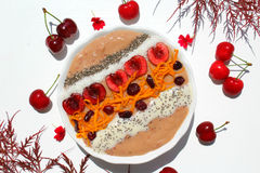 Smoothie brown bowl. Smoothie rbrown bowl with red berry cherry and chia seed Royalty Free Stock Photography