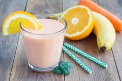 Smoothie with carrot, banana, orange and yogurt Stock Photo