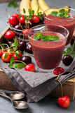 Smoothie with cherry and banana Royalty Free Stock Photos