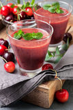 Smoothie with cherry  in a glass Stock Images
