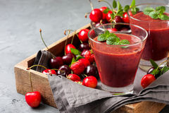 Smoothie with cherry  in a glass Royalty Free Stock Image