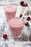 Smoothie with cherry in a glass Stock Photography