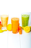 Smoothie day, time for healthy drink. Smoothie Day, time for health - apple-banana, carrot-orange and lemon organic with herbs Royalty Free Stock Photos