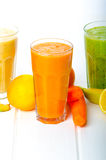 Smoothie day, time for healthy drink. Smoothie Day, time for health - apple-banana, carrot-orange and lemon organic with herbs Stock Photography