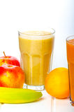 Smoothie day, time for healthy drink. Smoothie Day, time for health - apple-banana, carrot-orange and lemon organic with herbs Royalty Free Stock Photo