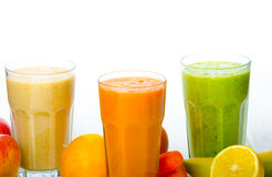 Smoothie day, time for healthy drink. Smoothie Day, time for health - apple-banana, carrot-orange and lemon organic with herbs Royalty Free Stock Photography