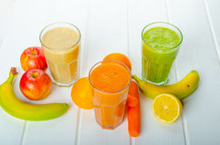 Smoothie day, time for healthy drink. Smoothie Day, time for health - apple-banana, carrot-orange and lemon organic with herbs Stock Image