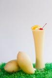 Smoothie del mango en blanco Imagen de archivo libre de regalías