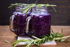 Smoothie drink from cabbage. Fresh smoothie drink from violet cabbage with green rosemary Royalty Free Stock Image