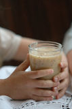 Smoothie drink in child's hand Royalty Free Stock Image