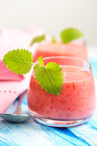 Smoothie drink with mint on table, in high key Royalty Free Stock Image