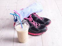 Smoothie drink with sport equiment royalty free stock image