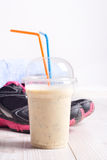 Smoothie drink with sport equipment Royalty Free Stock Photography