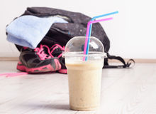 Smoothie drink with sport equipment Stock Photography