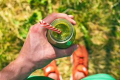 Smoothie drink a sport man in a nature. Glasses of smoothie with berry and mint. Berry, leaf and lime, raspberriesFruit Healt. Hy food royalty free stock image