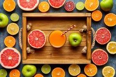 Smoothie or fresh juice in wooden tray, healthy lifestyle vegan organic antioxidant detox diet. stock photos
