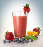 Smoothie. Fruit with glass and berries on grey Royalty Free Stock Photo