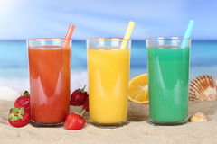 Smoothie fruit orange juice with fruits on the beach Stock Photography