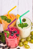 Smoothie in a glass and fresh fruits and berries Royalty Free Stock Photography