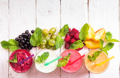 Smoothie in a glass and fresh fruits and berries Stock Photos