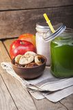 Smoothie in glass jar on rustik wood. Green healthy beverage and royalty free stock images