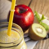 Smoothie in glass jar on rustik wood. Green healthy beverage and stock photography