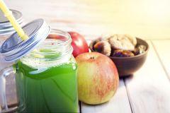 Smoothie in glass jar on rustik wood. Green healthy beverage and. Fresh fruit Royalty Free Stock Images