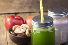 Smoothie in glass jar on rustik wood. Green healthy beverage and. Fresh fruit Royalty Free Stock Photos