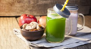 Smoothie in glass jar on rustik wood. Green healthy beverage and. Fresh fruit Royalty Free Stock Image