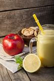 Smoothie in glass jar on rustik wood. Healthy beverage and fresh. Fruit Stock Image